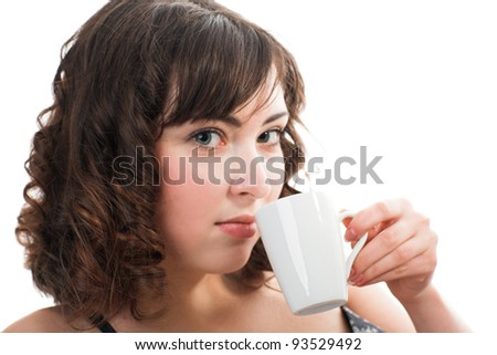 Portrait of young beauty woman drinking coffee