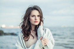 Portrait of young beauty woman with long brown hair outdoor. Romantic vacation