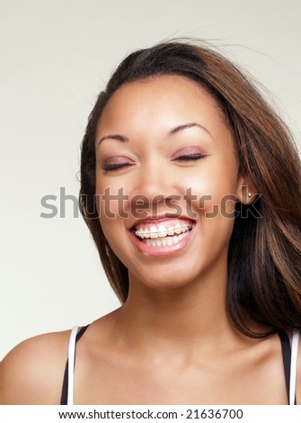Portrait of young black woman big smile eyes closed - stock photo