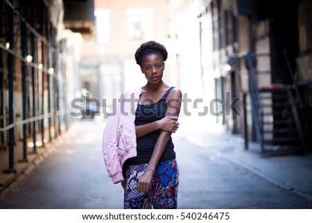Portrait of young black woman on city street, photographed in NYC in September