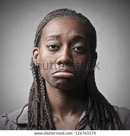 portrait of young black woman sad