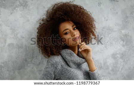 Portrait of young black woman wear high-neck wool and cashmere sweater