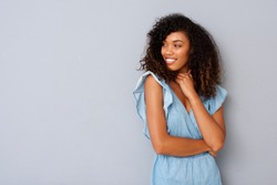Portrait of young black woman with curly hair looking at copy space