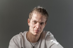 Portrait of young blond man photographed with natural light and casual clothes.