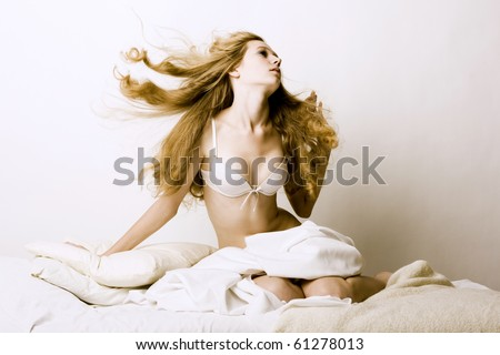 portrait of young blond woman in bed