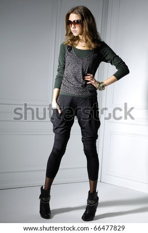 Portrait of young blonde girl in fashion dress wearing sunglasses #66477829