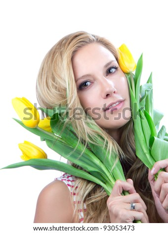 Portrait of young blonde woman with yellow spring tulips bouquet of flowers smiling isolated on white background