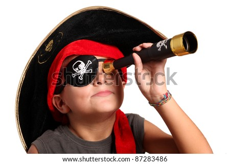 portrait of young boy dressed as pirate - stock photo