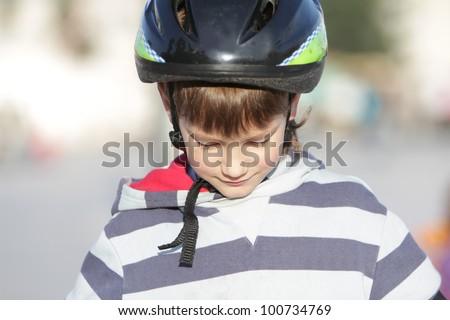 portrait of young boy in sport helmet