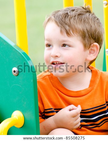 Portrait of young boy or kid on playground