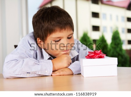Portrait of young boy waiting for present