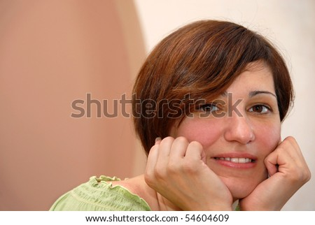 portrait of young brown-haired woman in casual cloth indoor