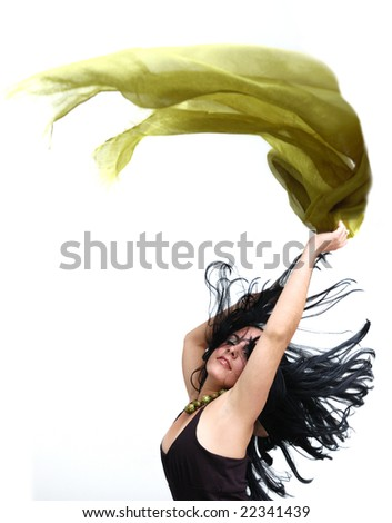 Portrait of young brunette beauty dancing - isolated