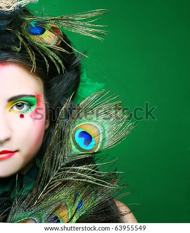 Portrait of young brunette in creative theatrical image.