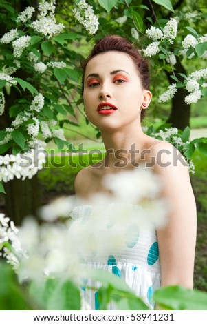 portrait of young brunette in the spring park