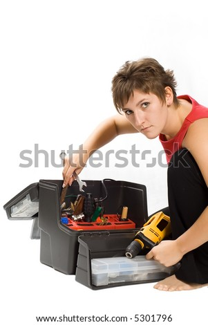 Portrait of young brunette with toolbox