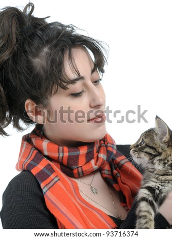 portrait of young brunette woman holding kitten on white background