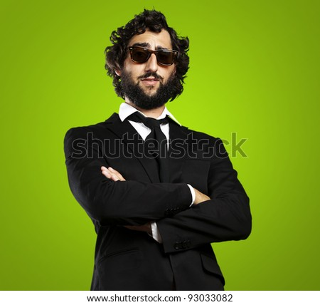 portrait of young business man against a green background