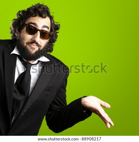 portrait of young business man confused against a green background - stock photo