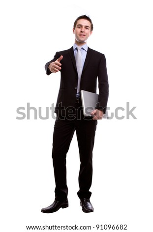 Portrait of young business man giving a hand shake with laptop  against white background