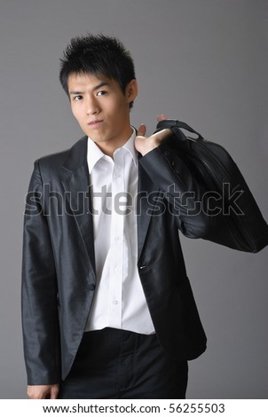 Portrait of young business man of Asian with briefcase.
