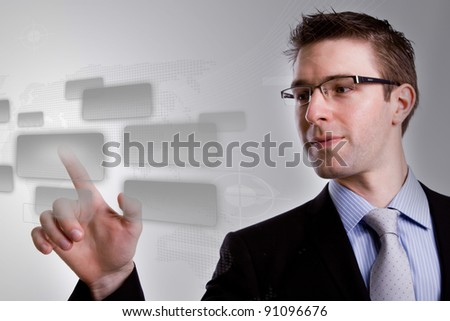 Portrait of young business man  pushing a button on a touch screen interface