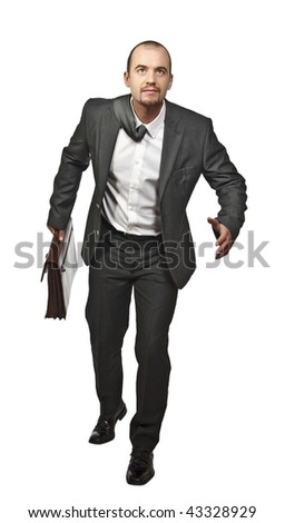 portrait of young business man running on white background