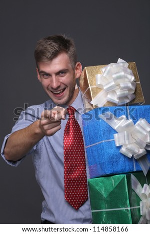 Portrait of young business man with gifts
