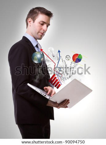 Portrait of young business man with laptop