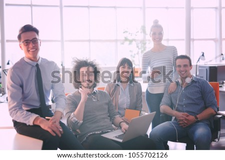 Portrait of young business people discussing business plan  in the office #1055702126