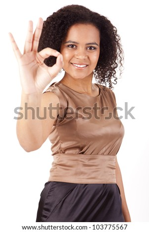 Portrait of young business woman doing Ok sign