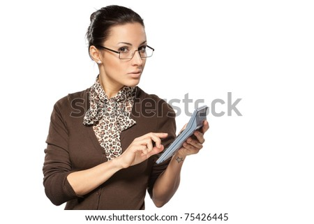 Portrait of young business woman making calculations with calculator isolated on white