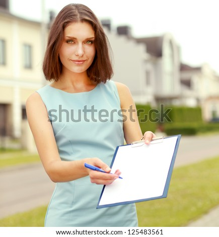 Portrait of young business woman on building background