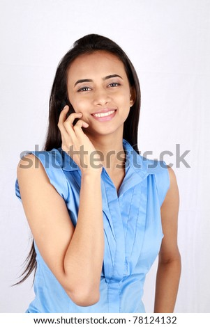 Portrait of young business woman on the phone.