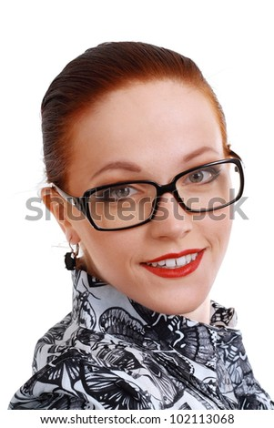 portrait of young business woman or teacher wearing eye-glasses and sly smile