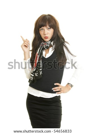 Portrait of young business woman pointing at corner