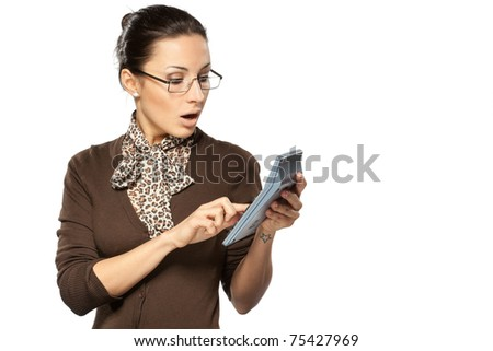 Portrait of young business woman shocked with her accounts made with calculator isolated on white