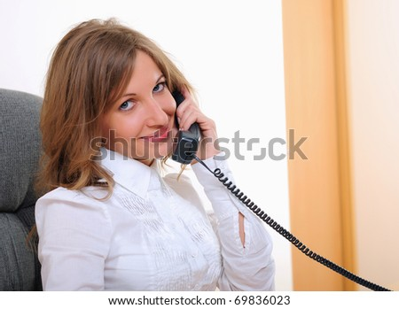Portrait of young business woman talking on phone