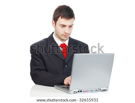 Portrait of young businessman  in front of the laptop