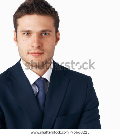 Portrait of young businessman on white background, looking at you. - stock photo