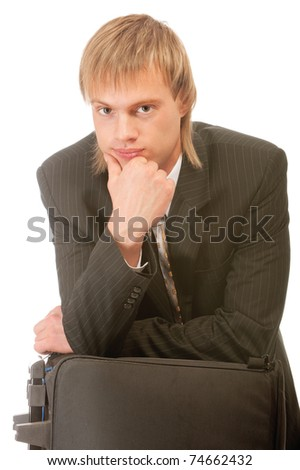 Portrait of young businessman thinking with hand on chin, isolated on white background.