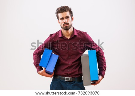 Portrait of young businessman who is unmotivated and overworked.