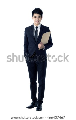 Portrait of young businessman with a clipboard - Shutterstock ID 466437467