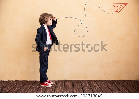 Portrait of young businessman with drawn airplane. Success, creative and start up concept. Copy space for your text #306713045