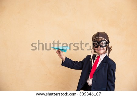 Portrait of young businessman with paper airplane. Success, creative and start up concept. Copy space for your text #305346107