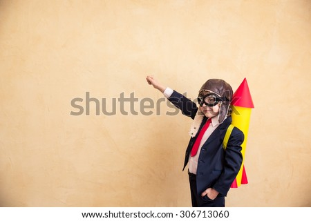Portrait of young businessman with paper rocket. Success, creative and start up concept. Copy space for your text #306713060