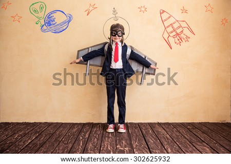 Portrait of young businessman with toy paper wings. Success, creative and start up concept. Copy space for your text #302625932