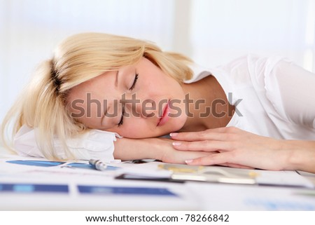 portrait of young businesss woman sleeping at work