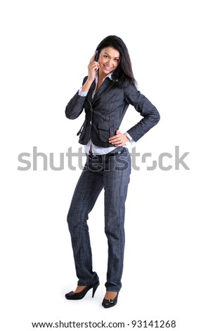 Portrait of young businesswoman talking on mobile phone  isolated on white background