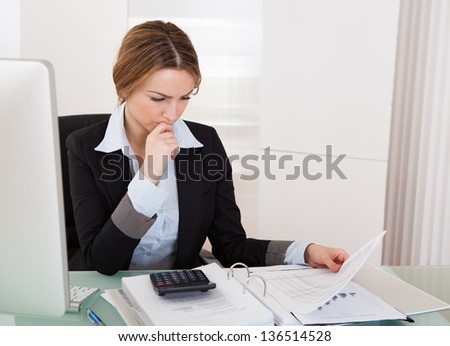 Portrait Of Young Businesswoman Working In Her Office